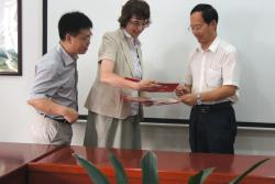 Dr Linda Farmer receiving certificates from Professor Dequan Zhang and Professor Changjiang Wang, to mark her appointment as Distinguished Professor and Distinguished International Supervisor at the Chinese Academy of Agricultural Sciences (CAAS).