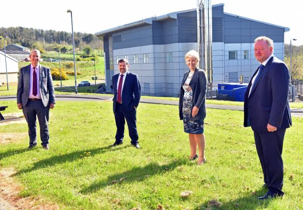 DAERA Minister Edwin Poots, Department of Health Minister Robin Swann pictured with Josephine Kelly, AFBI Director and Alastair Douglas, Head of AFBI Veterinary Sciences Division