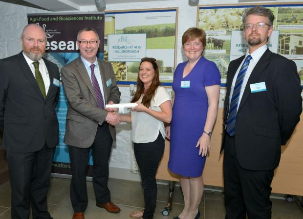 Suzanne Beck receiving her prize for best poster presentation from Dr Stanley McDowell, AFBI DCEO