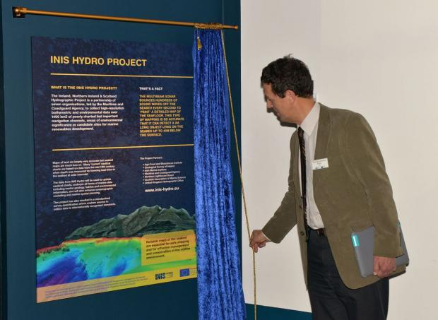 Professor Laurence Mee (Scottish Association of Marine Sciences) unveiling the permanent display board in the Titanic Builiding.