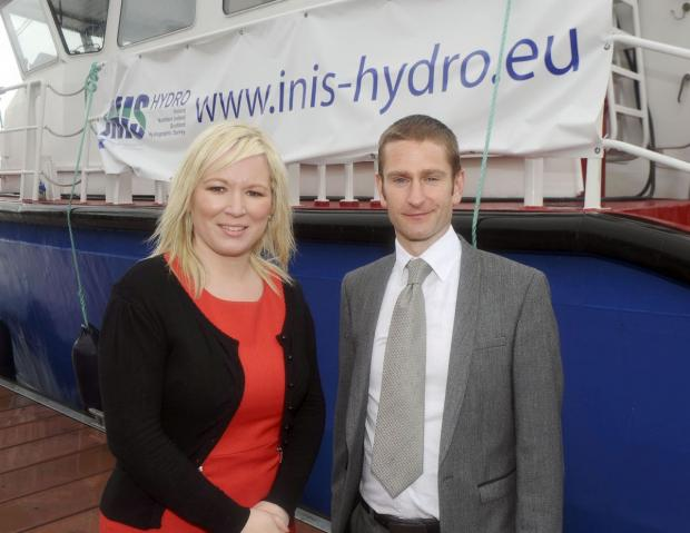 James Strong (AFBI Fisheries and Aquatic Ecosystems Branch) and Michelle O'Neill (Minister of Agriculture and Rural Development NI) pictured in front of the DARD FPV Banrion Ulladh which was used during the survey.