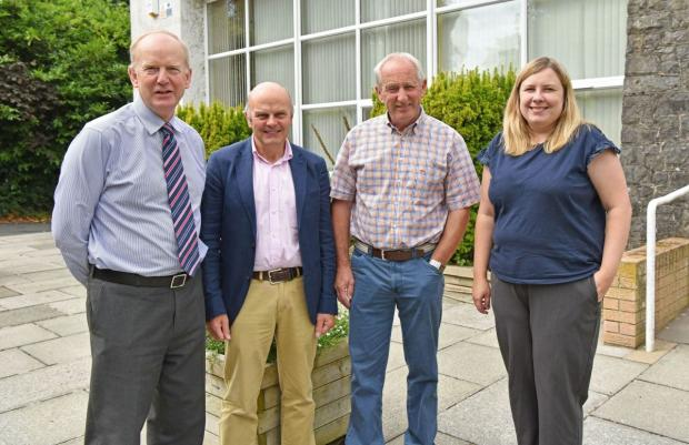 Pictured (L-R) Sinclair Mayne (AFBI CEO), Jim McAdam (Head of Grassland and Plant Sciences Branch), David Johnston and Gillian Young (Grass Breeder, AFBI Loughgall).