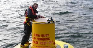 Dr Adam Mellor (AFBI) on a research buoy