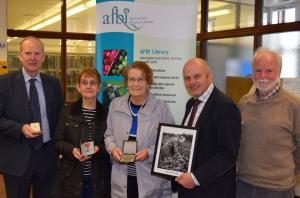 John Clarke's daughter, Miriam Hanna and niece, Rosemary McGarry, bring material for an exhibit to celebrate his achievements in potato breeding in Northern Ireland.