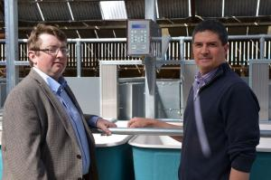 Conrad Ferris (AFBI), pictured right and Jason Rankin (AgriSearch) discuss the new individual cow feed intake and feeding behaviour monitoring equipment that will be used in the precision feeding studies at AFBI, Hillsborough
